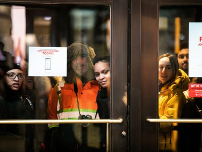 shoppers waiting outside of Macy's for Black Friday shopping
