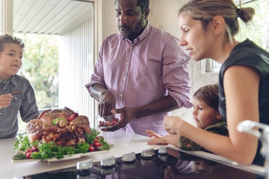 mom and dad serve turkey with their kids