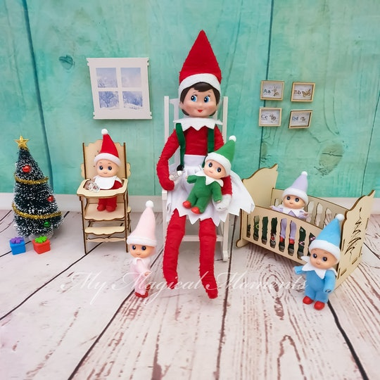 Elf on the shelf, with elf babies in a high chair and crib!