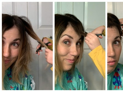 A toddler cuts her mom's hair