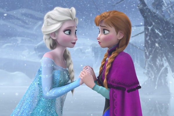 Anna and Elsa from 'Frozen' hold hands outside as it snows.