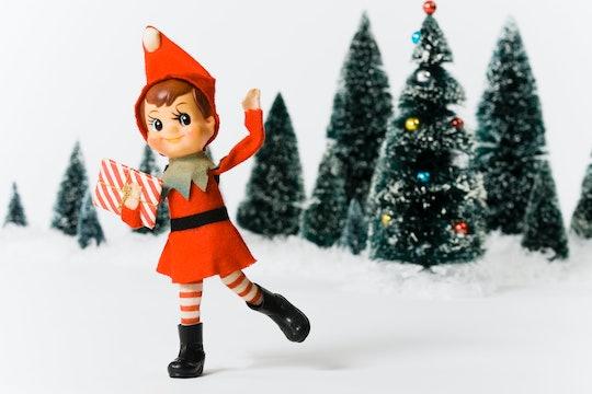 vintage elf doll throwing snow