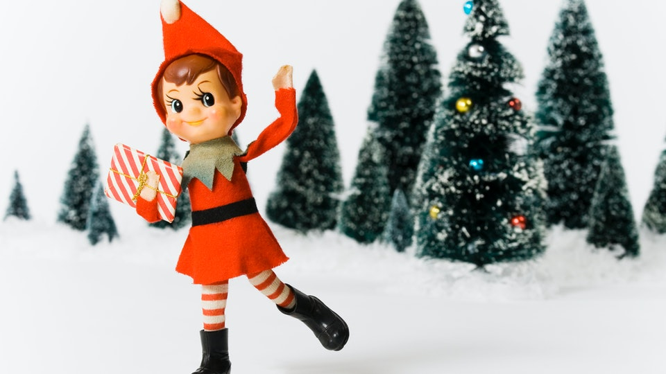 vintage elf doll throwing snow