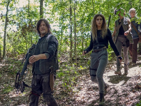 Norman Reedus as Daryl Dixon, Nadia Hilker as Magna, Lauren Ridloff as Connie, Melissa McBride as Carol, and Angel Theory as Kelly in The Walking Dead in Season 10
