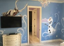 The walls come alive with 'Frozen' scenes in this home