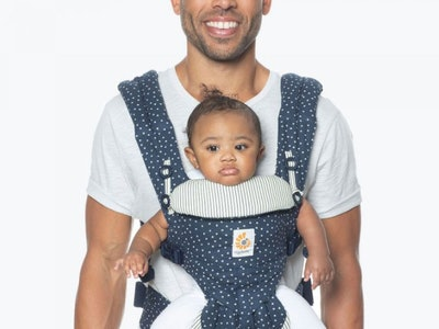 A dad wearing a baby in the Ergobaby Omni Baby Carrier All-in-one Galaxy