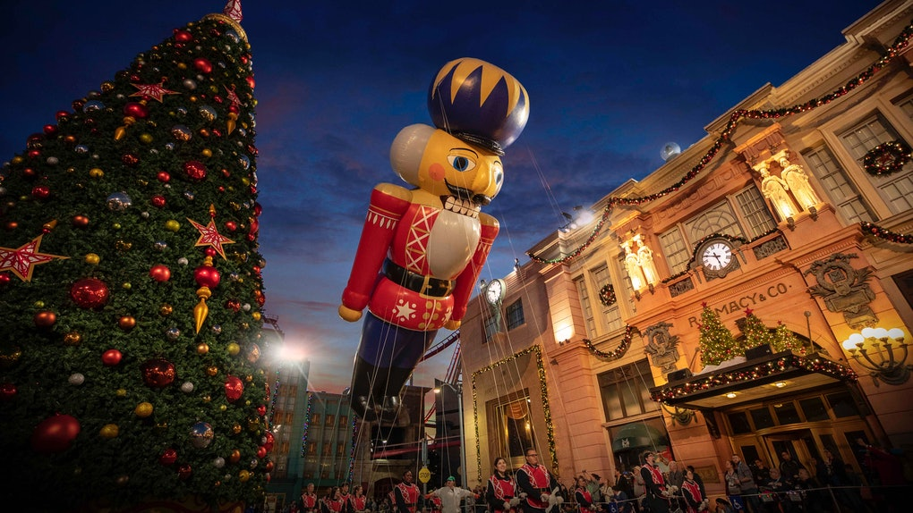 A nutcracker balloons flies over Universal Orlando during the holiday parade featuring Macy's.