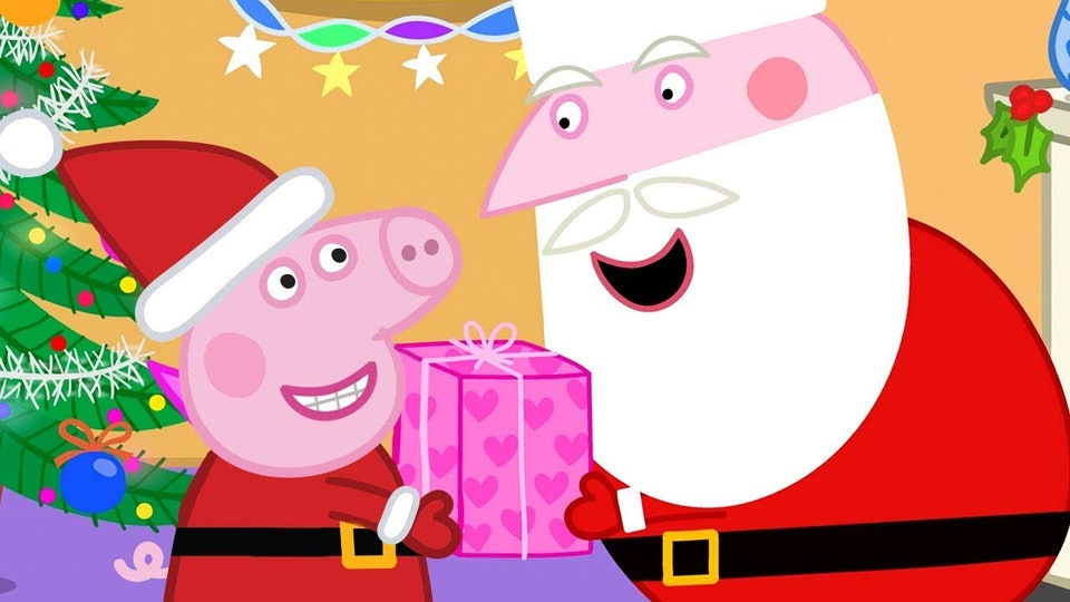 santa claus giving peppa pig a present in still from peppa episode