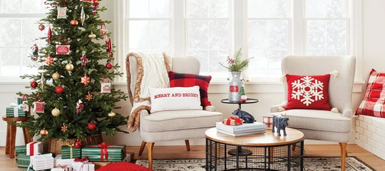 Target Holiday Decor Weekend Deal; neutral living room featuring bright red and green Christmas deco...
