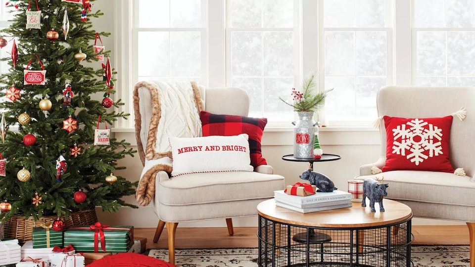 Target Holiday Decor Weekend Deal; neutral living room featuring bright red and green Christmas decor and Christmas tree