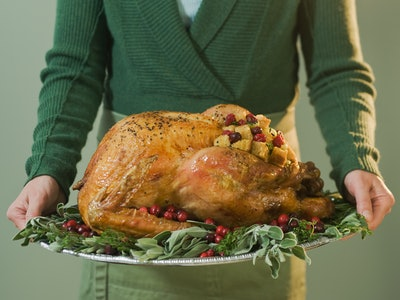 Man holding a turkey platter