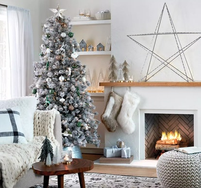 Target Christmas Decor Weekend Deal; neutral living room decorated with grey, silver, gold, and whit...