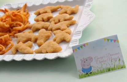 Tray of chicken nuggets with peppa Pig card.