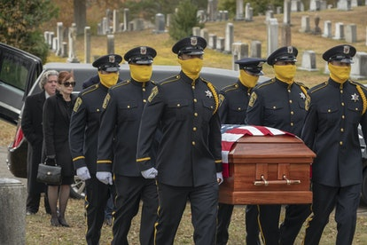 Masked cops at Judd Crawford's funeral in HBO's Watchmen.