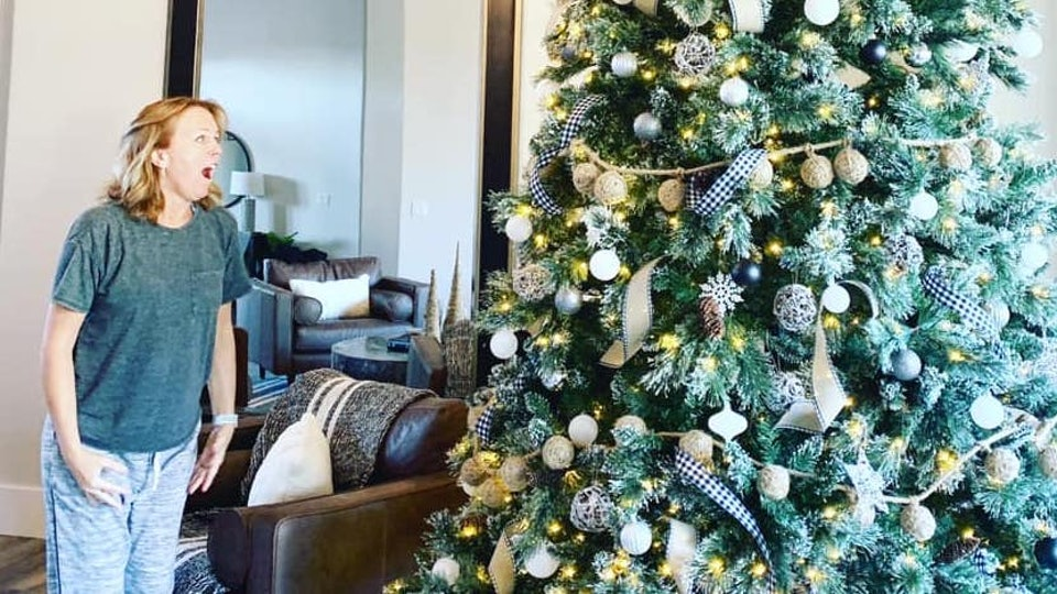 A husband surprised his wife with a giant Christmas tree.