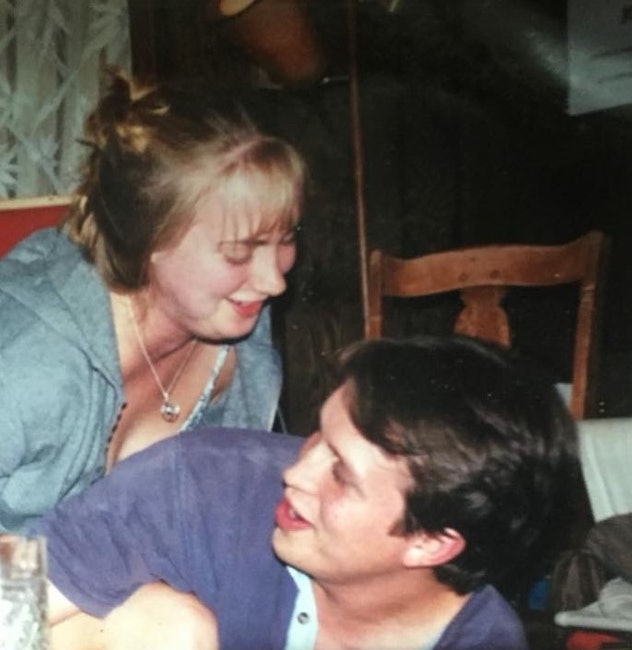 A picture of a man and woman laughing.