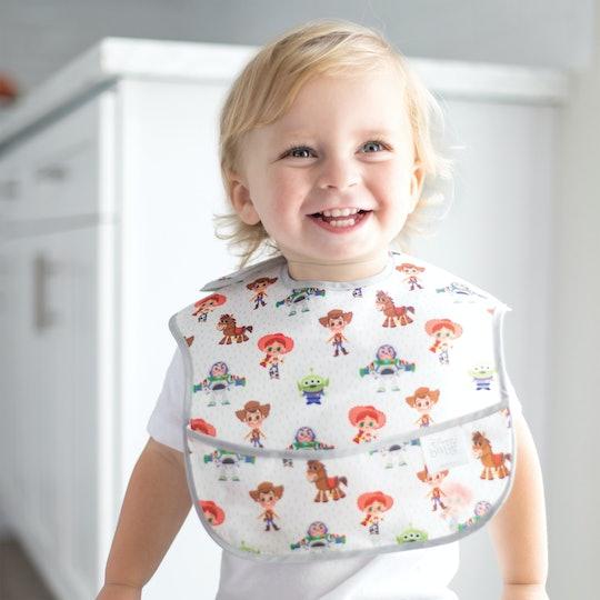 A baby boy wearing a Bumkins Disney bib