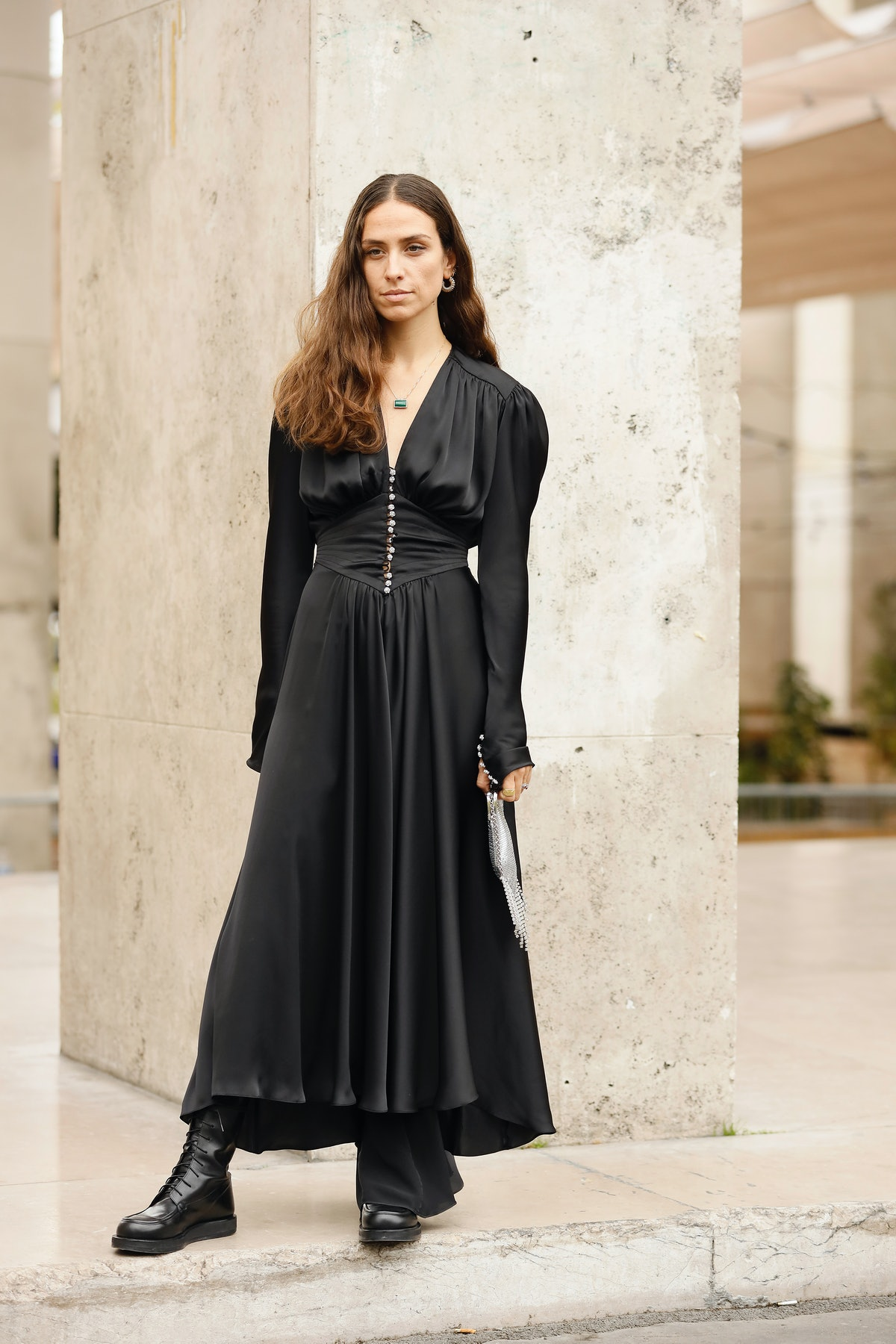 Street style photo of influencer Erika Boldrin wearing a black silk maxi dress and combat boots at P...