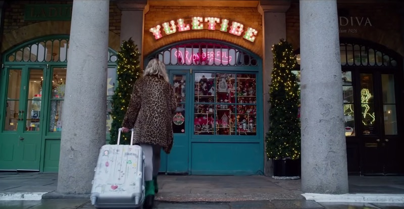 Emilia Clarke as Kate in front of the Yuletide Wonderful store in Last Christmas