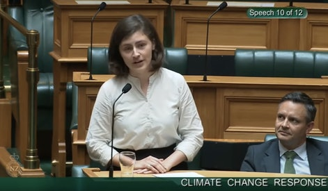 Chlöe Swarbrick speaking in front of New Zealand parliament.