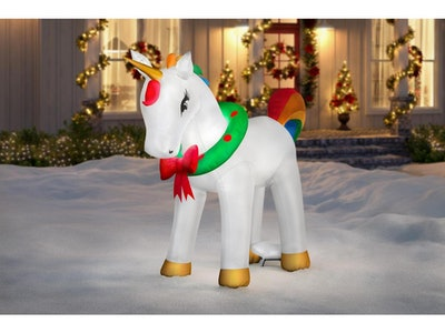 This unicorn Christmas inflatable features a wreath around its neck, rainbow mane and tail, and a metallic gold horn.