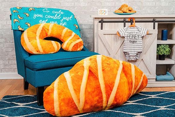 Cheddar's bundle for new parents includes a four foot long croissant body pillow.
