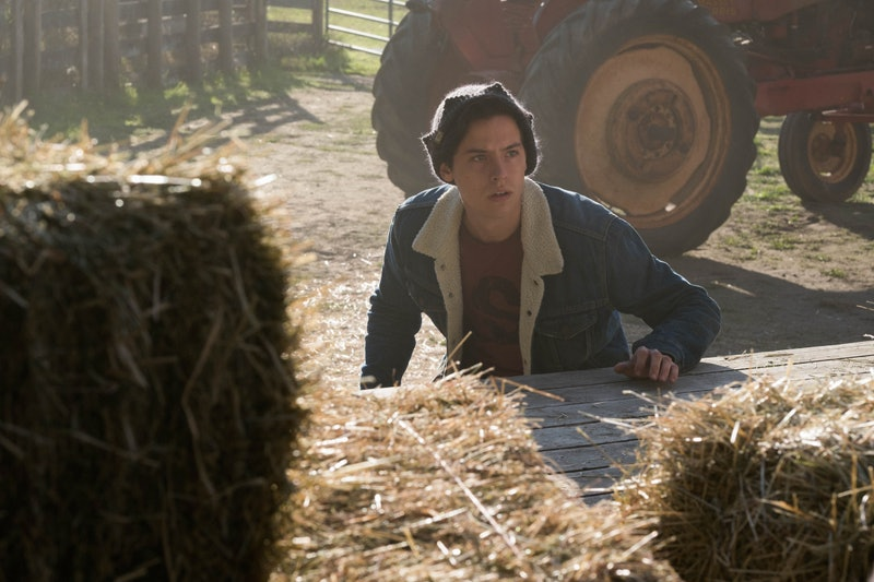 Jughead hiding behind hay bales on Riverdale