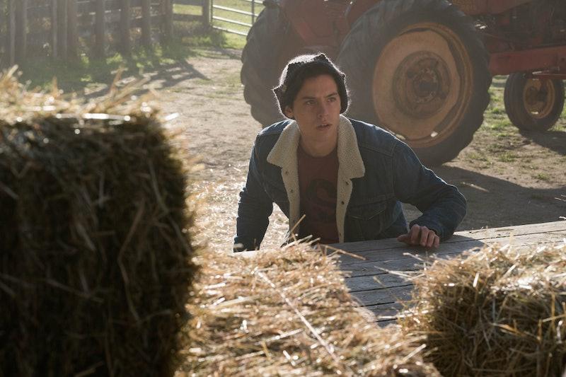 Jughead hiding behind hay bales on Riverdale
