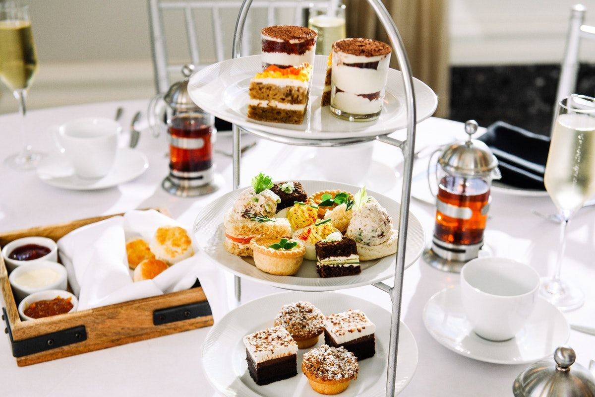 The spread at Waldorf Astoria Atlanta Buckhead's afternoon tea includes sweet pastries, breads, and ...