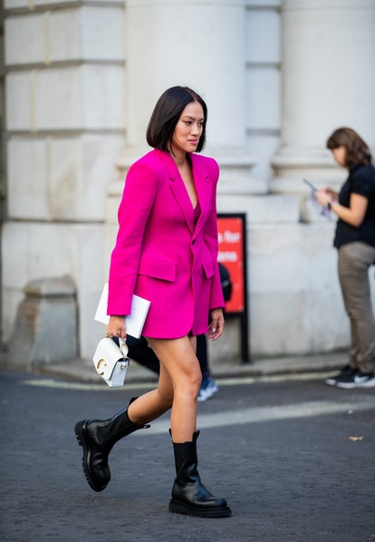 Street style photo of Tiffany Hsu wearing a pink blazer dress and combat boots at London Fashion Week Spring 2020.