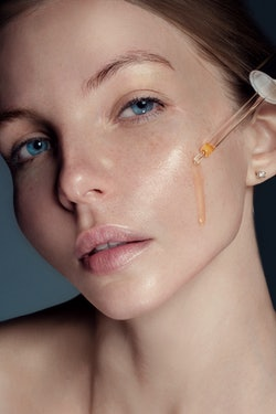 woman using facial oil