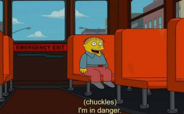 A Simpsons character alone on a bus, laughing that he's in danger.