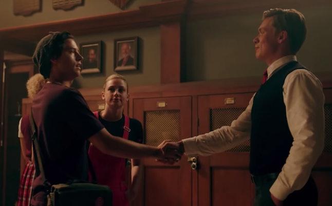 Bret Weston Wallis and Jughead shaking hands at Stonewall Prep on Riverdale