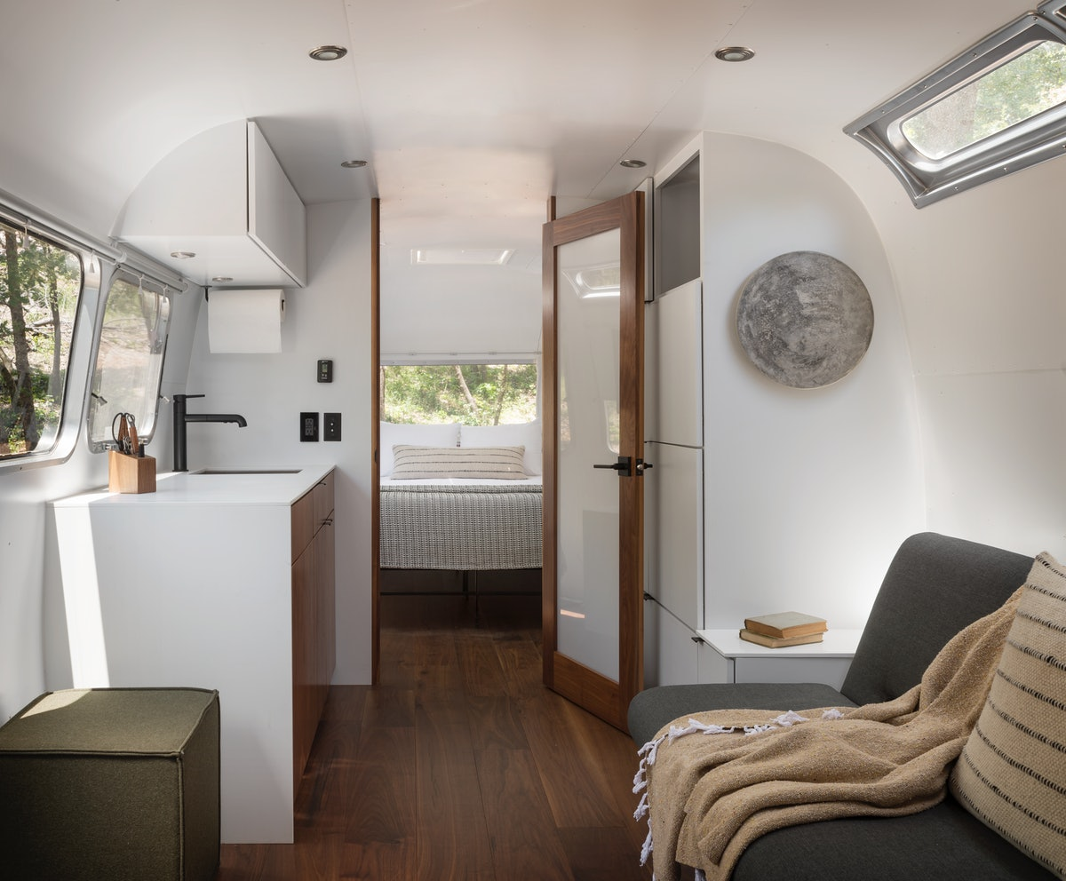 The interior of an AutoCamp airstream trailer is very luxe and decorated with nature-inspired details.