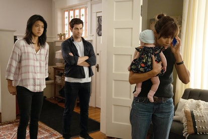 Delilah on the phone and holding Charlie while Katherine and Eddie watch on A Million Little Things