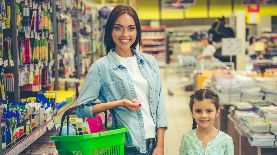 girl and her mom shop for stationary