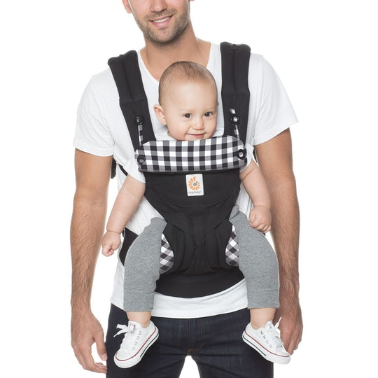 Dad holding baby in Ergobaby carrier