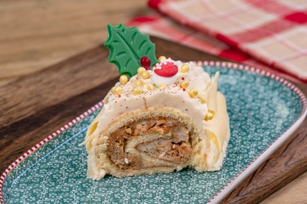 The churro yule log is available at Disneyland's holiday celebration.