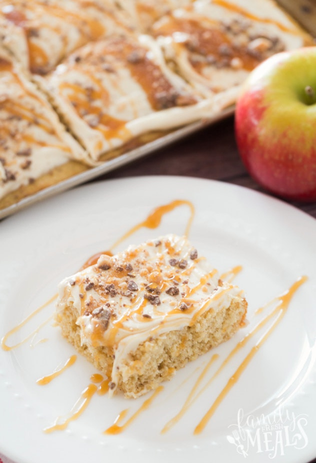 Thanksgiving sheet pan desserts, a cut square of caramel apple sheet cake on a white plate with caramel drizzled on top