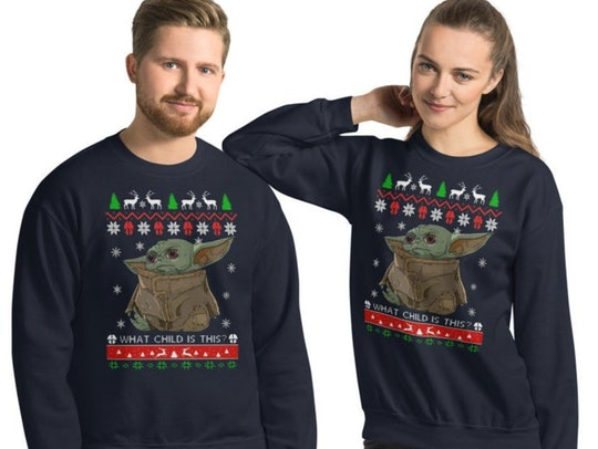 The Baby Yoda Christmas sweater is full of Christmas puns.