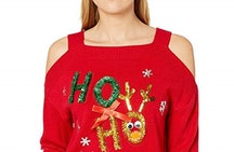 a woman wearing a sexy red ugly Christmas sweater