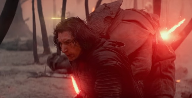 Adam Driver as Kylo Ren with a yellow blaster bolt behind his head in Star Wars: The Rise of Skywalker