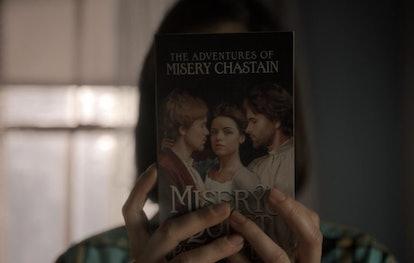 Annie holding Paul Sheldon's 'Misery' book in Castle Rock Season 2