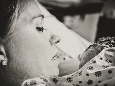 A mom holds her newborn
