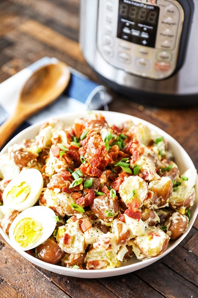 Bowl of potato salad mixed with bacon and hard boiled eggs