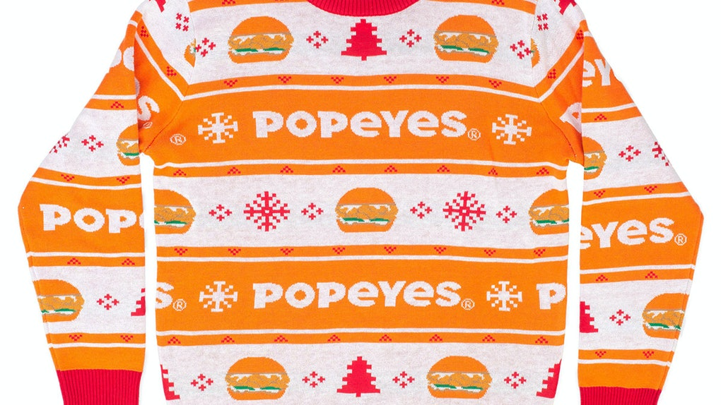 Popeyes' 2019 Ugly Holiday Sweater has the Popeyes'Chicken Sandwich on it, so you can wear your fave bite during the holidays.