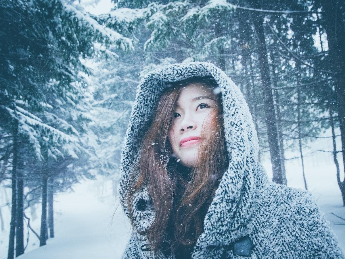 Asian girl in winter snow