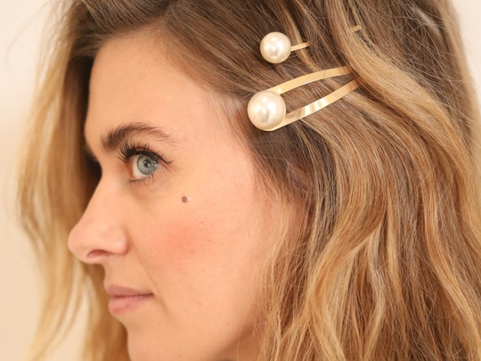 Secure the side of your hair with R+Co's new pearl hair pins for a festive look
