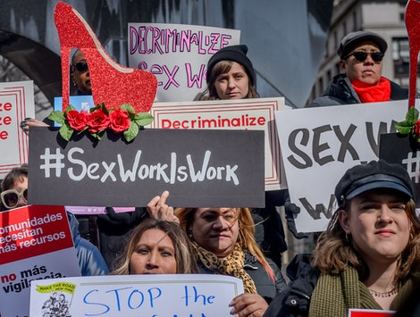 Protestors call for full decriminalization of sex work.