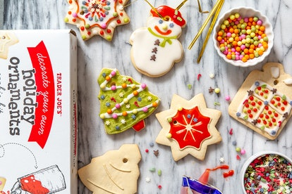 Trader Joe's Decorate Your Own Holiday Ornaments Cookie Kit comes complete with 8 cookies and a variety of decorations.